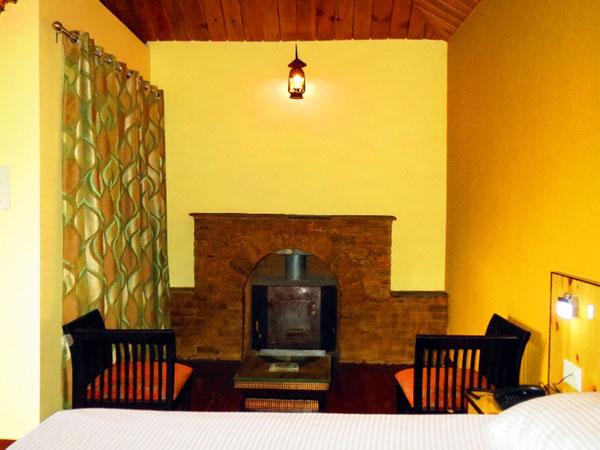 fireplace in cottages himalaya darshan resort photos