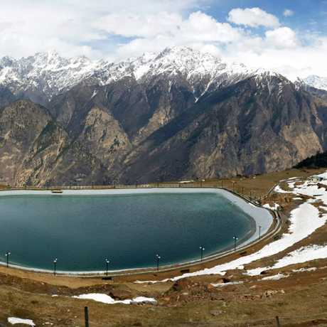 A beautiful view of artificial lake at Auli and snow capped peaks in the backdrop.