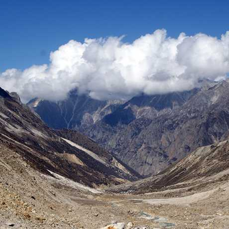 Clouds are flying over the mountains of Gangotri National Park, near Gaumukh