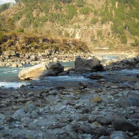 The confluence of Nandakini River (foreground) with Alaknanda River (background) in Nandprayag
