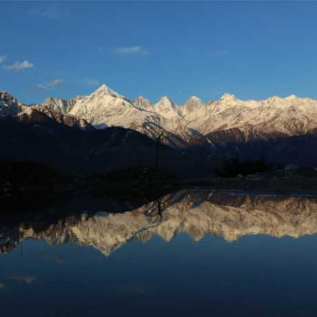Stunning view of Panchchuli peaks and its beautiful reflection in water.